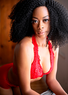 Boudoir image of black girl in red bra