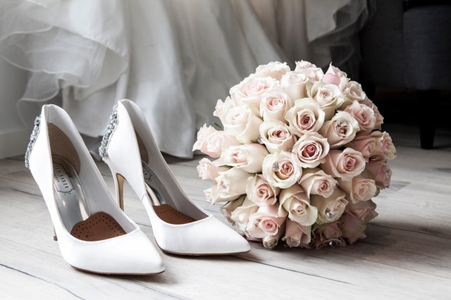 White wedding shoes with bouquet