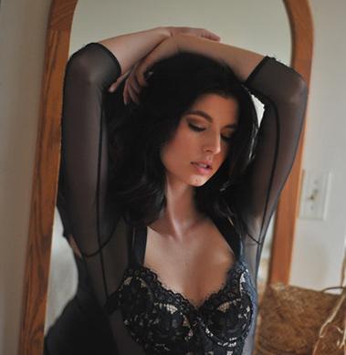 Boudoir image of woman in black lingerie