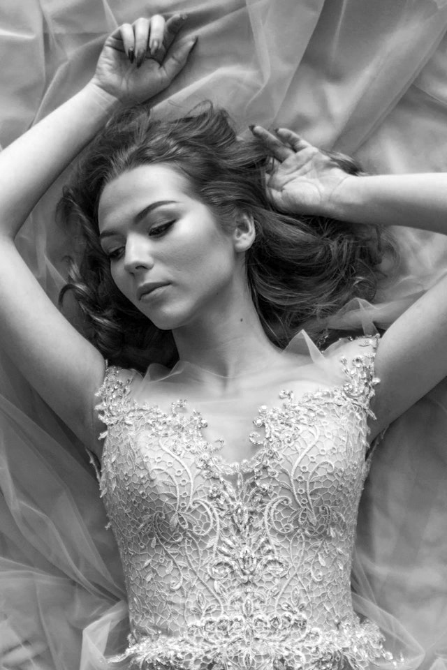 Black and white bride laying on bed
