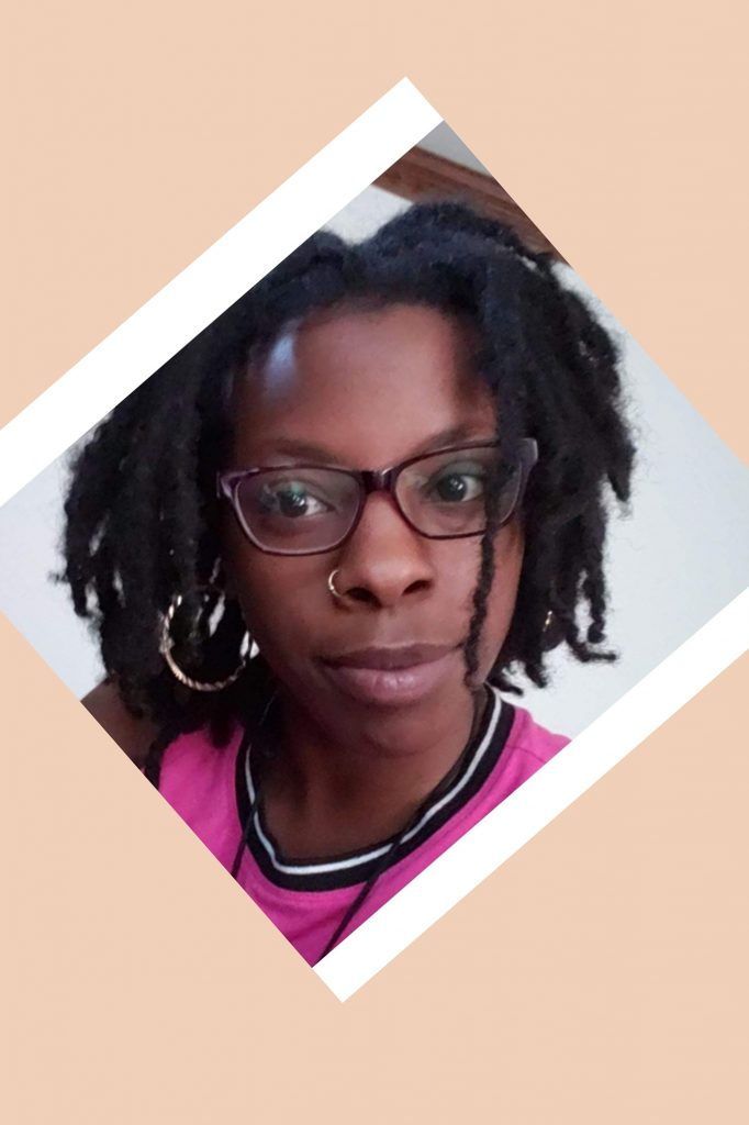 Headshot of young black girl with short dreads and glasses