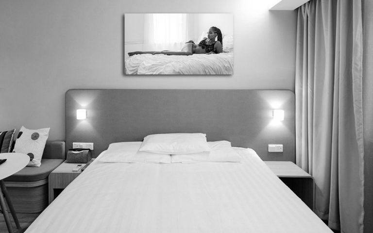 Black and white boudoir metal print in bedroom