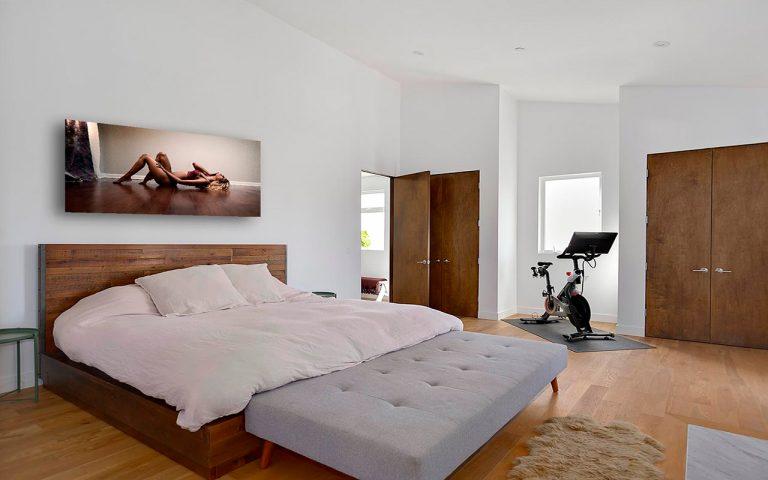 Boudoir print above bed.
