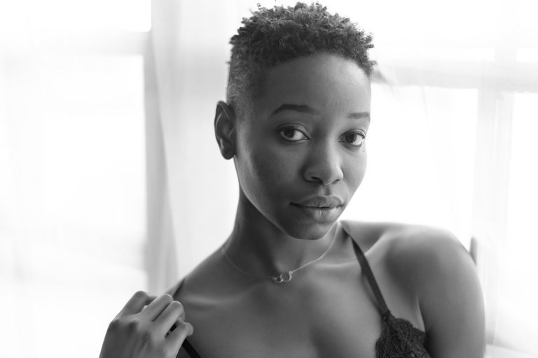 Black and white boudoir closeup of young black woman