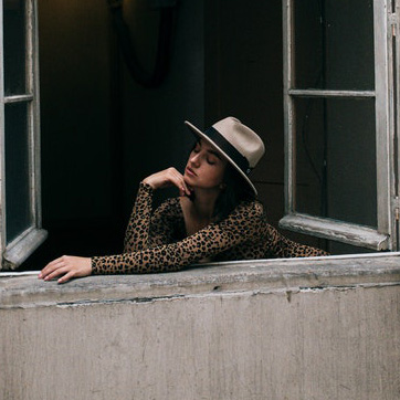 Woman in a fedora