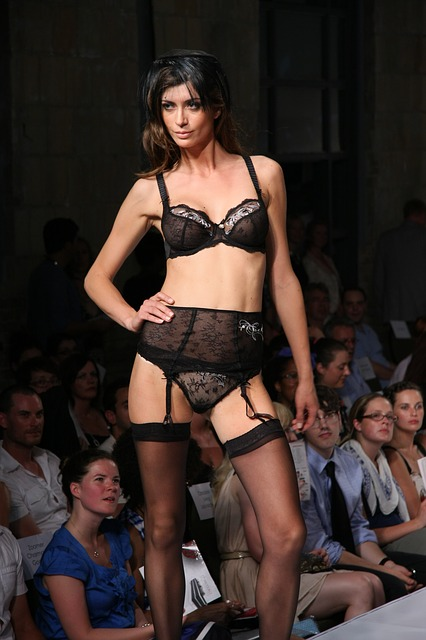 Woman in garter belt and thigh-high fishnet stockings