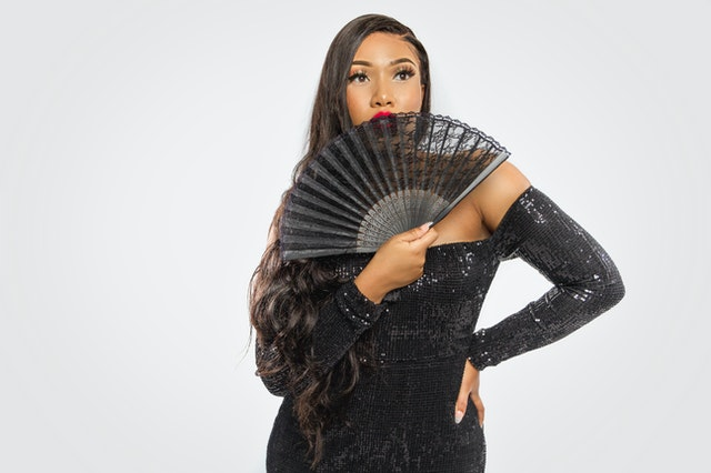 Woman with black lacy hand fan